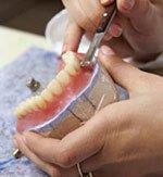 Lab making denture.