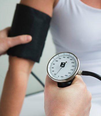 Dentist taking blood pressure.